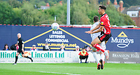 Lincoln City's Tyler Walker scores the opening goal, as he gets to the ball before Sunderland's Jon McLaughlin<br /> <br /> Photographer Chris Vaughan/CameraSport<br /> <br /> The EFL Sky Bet League One - Lincoln City v Sunderland - Saturday 5th October 2019 - Sincil Bank - Lincoln<br /> <br /> World Copyright © 2019 CameraSport. All rights reserved. 43 Linden Ave. Countesthorpe. Leicester. England. LE8 5PG - Tel: +44 (0) 116 277 4147 - admin@camerasport.com - www.camerasport.com