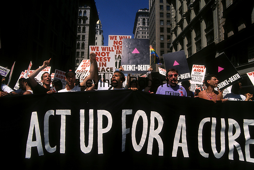 Hundreds of members of the activist group ACT UP (AIDS Coalition to Unleash Power) protest the lack of an effective treatment for AIDS on Fifth Avenue in June 1991 in the Gay Pride parade.  (© Frances M. Roberts)