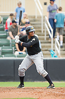 Edwin Espinal (14) of the West Virginia Power at bat against the Kannapolis Intimidators at CMC-Northeast Stadium on April 30, 2014 in Kannapolis, North Carolina.  The Intimidators defeated the Power 2-1 in game one of a double-header.  (Brian Westerholt/Four Seam Images)