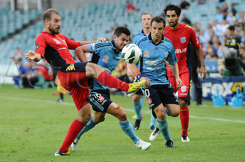 16.02.2013 Sydney, Australia. Sydney midfielder Joel Chianese and Adelaide defender Iain Fyfe in action during the Hyundai A League game between Sydney FC and Adelaide United from the Allianz Stadium.