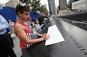 On the 10th anniversary of the September 11th attacks, Ruth Lafuente Jacobsen traces the name of her father, Juan Mendez Lafuente, who died in the 9/11 attacks, at the North Memorial Pool at opening day of the September 11th Memorial at the World Trade Center site in New York, New York on Sunday, September 11, 2011..Credit: Jefferson Siegel / Pool via CNP