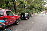 Two vehicules that were broken into during the night on 12th Avenue in New York City, NY, USA as tropical storm Irene was hitting the region, 28 August 2011. A flooded section of the Avenue is visible in the background. Another other vehicule parked nearby had a smashed window.