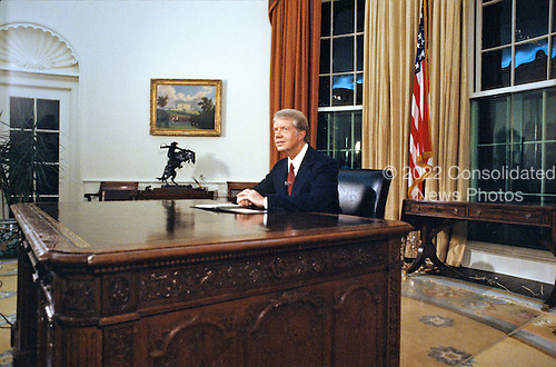 United States President Jimmy Carter delivers his Address to the Nation on Inflation from the Oval Office of the White House in Washington, DC on October 24, 1978.<br /> Credit: CNP