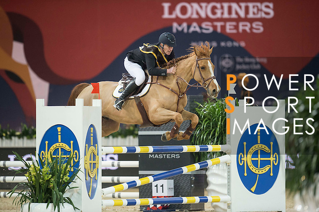 Team magic: Rider Roger-Yves Bost of France and Jockey Joao Moreira of Brazil compete during the Hong Kong Jockey Club Race of the Riders, part of the Longines Masters of Hong Kong on 10 February 2017 at the Asia World Expo in Hong Kong, China. Photo by Juan Serrano / Power Sport Images