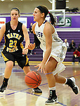 SIOUX FALLS, SD - DECEMBER 6:  Taylor Varsho #3 from the University of Sioux Falls drives against Addy Roller #23 from Wayne State in the first half of their game Friday night at the Stewart Center. (Photo by Dave Eggen/Inertia)