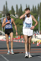 02 NOV 2003 - ATHENS, GREECE - Competitors recover after finishing the 21st Athens Classic Marathon. (PHOTO (C) NIGEL FARROW)