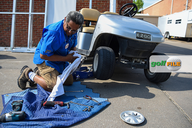 A Colonial worker changes a flat right front tire on a cart near the media center during round 3 of the 2019 Charles Schwab Challenge, Colonial Country Club, Ft. Worth, Texas,  USA. 5/25/2019.<br /> Picture: Golffile | Ken Murray<br /> <br /> All photo usage must carry mandatory copyright credit (© Golffile | Ken Murray)