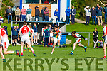 Liam Carey of Mid Kerry about to shoot for a score as Donal Maher of Kilcummin is about to block his effort in the County Football championship game in Killorglin on Sunday.