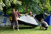 Participants pitch a tent on Sziget festival held in Budapest, Hungary on August 07, 2011. ATTILA VOLGYI