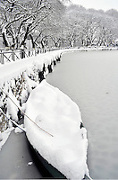 Pictured: A boat is covered in snow in the partially frozen over lake in Ioannina, Greece. Wednesday 11 January 2017<br /> Re: Heavy snow has affected the town of Ioannina, northern Greece