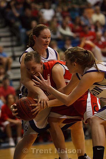 Taylorsville - Riverton vs. American Fork High School girls basketball, 5A State Championship game Saturday February 28, 2009 at Salt Lake Community College..American Fork's Kylie Allen (23) Riverton's Angie Smith (30) Riverton's Shaye Murphy (40)