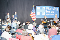 A Syrian man asks a question about treatment of refugees to Democratic presidential candidate and former First Lady and Secretary of State Hillary Rodham Clinton as she speaks at the Women's Economic Opportunity Summit at Southern New Hampshire University in Hooksett, New Hampshire.