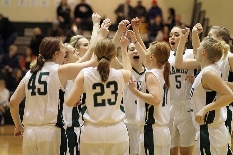 Photograph from the 2010-11 Mt. Rainier Lutheran High School girl's basketball season.