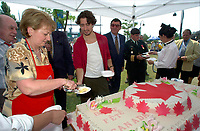 July 1 2002, Montreal, Quebec, Canada<br /> <br /> Lucienne Robillard, President Treasury Board of canada (L), get help from<br /> Justin Trudeau, Former Canada Prime Minister Pierrre E TRudeau's son (R) to cut a giant cake distributed to people attending the Canada day celebrations,  July 1st 2001, in the Old-Port of Montreal. <br /> <br /> Mandatory Credit: Photo by Pierre Roussel- Images Distribution. (©) Copyright 2002 by Pierre Roussel
