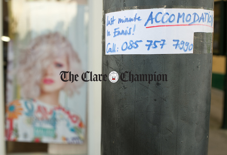 An advt for last minute accommodation on a pole in O Connell street, during Fleadh Cheoil na hEireann. Photograph by John Kelly.