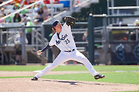 Andrew Moore (23) of the Everett Aquasox delivers a pitch during a game against the Vancouver Canadian at Everett Memorial Stadium in Everett, Washington on July 28, 2015.  Everett defeated Vancouver 8-5. (Ronnie Allen/Four Seam Images)