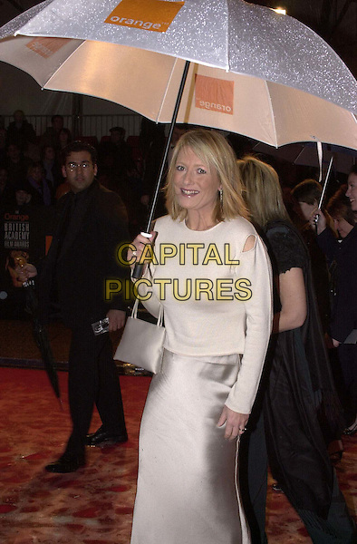 GABY ROSLIN.Arrivals at the British Academy of Film, Television & Arts Awards (BAFTAS), Odeon Leicester Square.Ref: 11498.umbrella, half length, half-length.*RAW SCAN - photo will be adjusted for publication*.www.capitalpictures.com.sales@capitalpictures.com.© Capital Pictures