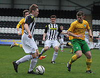 Barry Cuddihy being watched by Calum Waters in the St Mirren v Celtic Scottish Professional Football League Under 20 match played at St Mirren Park, Paisley on 30.4.14.
