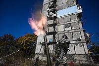 Pro-Russian rebel shoots mortars against Ukrainian army positions in Donetsk