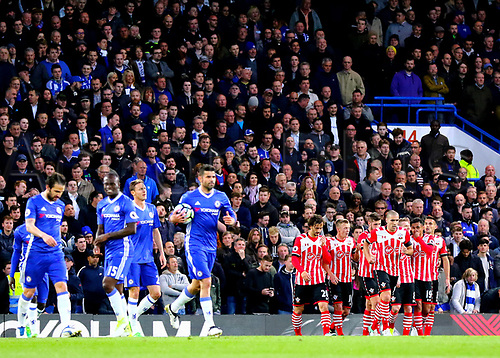 April 25th 2017, Stamford Bridge, Chelsea, London England; EPL Premier league football, Chelsea FC versus Southampton; Oriol Romeu of Southampton leads team mates back to their positions after he makes it 1-1 in the 24th minute, as Diego Costa of Chelsea takes the ball back to the centre spot