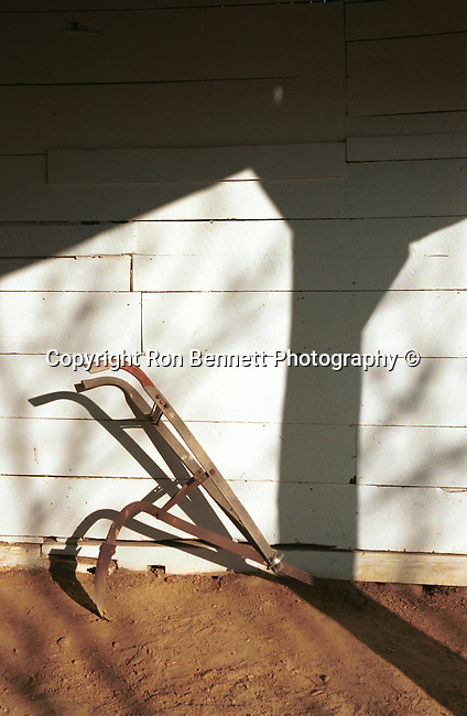 Plow in barn with shadow Commonwealth of Virginia, Fine Art Photography by Ron Bennett, Fine Art, Fine Art photography, Art Photography, Copyright RonBennettPhotography.com ©