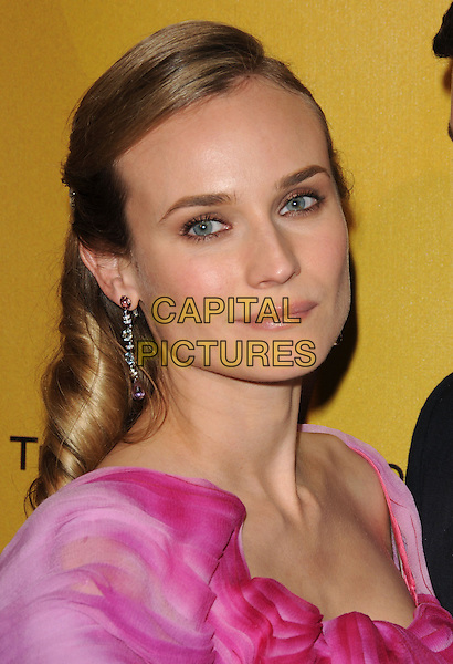 DIANE KRUGER .At Weinstein Company Post Golden Globe Party held at Bar210 & Plush Ultra Lounge in Beverly Hills, California, USA. January 17th, 2010                                                                   globes headshot portrait pink silk satin dangling earrings .CAP/DVS.©Debbie VanStory/Capital Pictures