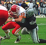 Oakland Raiders vs. Kansas City Chiefs at Oakland Alameda County Coliseum Sunday, November 5, 2000.  Raiders beat Chiefs  49-31.  Oakland Raiders defensive end Darrell Russell (96) sacks Kansas City Chiefs quarterback Elvis Grbac (18).