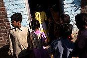 Children gather outside a house in village Wathorakurd, in Amrawati district of Maharashtra. The students study a specially designed concept of 'aflatoon' as part of the curriculam whereby they are made aware of their child rights as described in the convention of rights of child. These students are made aware of right to survival, right to protection, right to development and right to participation.