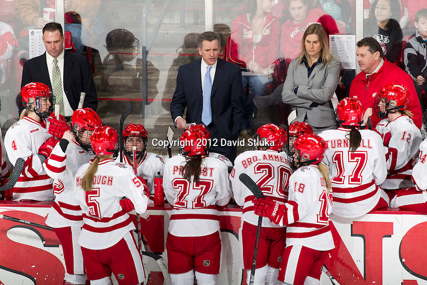 Wisconsin Badgers Head Coach Mark Johnson, center, talks to his team during a WCHA Conference NCAA college women's hockey game against the Ohio State Buckeyes on Saturday, February 18, 2012 in Madison, Wisconsin. Ohio State won 4-2. (Photo by David Stluka)