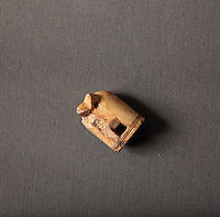 An ivory chesspiece, 10th - 11th centuries, made into a whistle (called 'le fou chantant') in the 15th century and discarded in the 16th century, from the 1995 excavations led by Francois Blary, from the North section of the upper courtyard in the kitchen area at the medieval castle of Chateau-Thierry, Picardy, France. The first fortifications on this spur over the river Marne date from the 4th century and the first castle was built in the 9th century Merovingian period by the counts of Vermandois. Thibaud II enlarged the castle in the 12th century and built the Tour Thibaud, and Thibaud IV expanded it significantly in the 13th century to include 17 defensive towers in the walls and an East and South gate. The castle was largely destroyed in the French Revolution after having been a royal palace since 1285. In 1814 it was used as a citadel for Napoleonic troops. Picture by Manuel Cohen