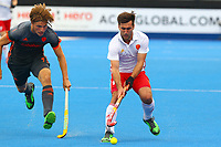 Adam Dixon of England and Jorrit Croon of the Netherlands compete for the ball during the Hockey World League Semi-Final match between England and Netherlands at the Olympic Park, London, England on 24 June 2017. Photo by Steve McCarthy.