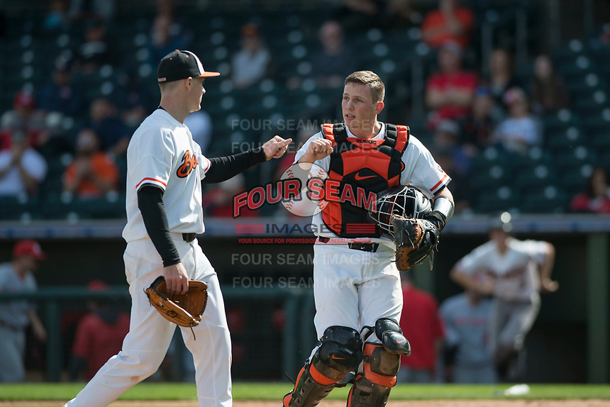 Oregon State Beavers starting pitcher Kevin Abel (23) and catcher Adley Rutschman (35) during a game against the New Mexico Lobos on February 15, 2019 at Surprise Stadium in Surprise, Arizona. Oregon State defeated New Mexico 6-5. (Zachary Lucy/Four Seam Images via AP)