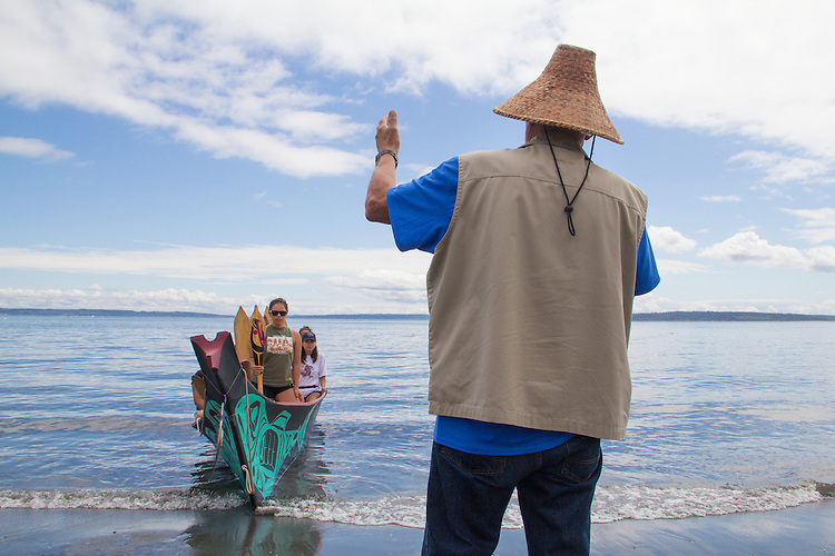 Canoe Journey, Paddle to Nisqually, 2016, Marlin Holden, Executive Director of the Jamestown S'Kallam Tribe welcomes Swinomish tribal canoes landing, , Port Townsend, Fort Worden, en route to Olympia, Washington State, Olympic Peninsula, Puget Sound, Salish Sea, USA,