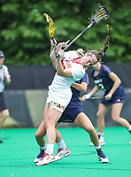 College Park, MD - May 19, 2018: Maryland Terrapins Megan Whittle (23) gets hit in the head during the quarterfinal game between Navy and Maryland at  Field Hockey and Lacrosse Complex in College Park, MD.  (Photo by Elliott Brown/Media Images International)