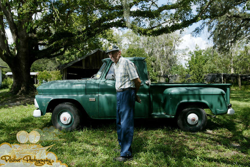 "Wilson ""Rainy"" Rainwater <cq>, 88, stands with his 1966 Chevrolet Stepside C-10 pickup truck Thursday, September 13, 2007, at his home in Pierson. Rainwater has replaced the engine and made a few other adjustments, but hasn't had any other major issues. Consumer Reports says car and truck owners can save a lot of money by keeping their vehicles until the odometer reaches 200,000 or more. (Daytona Beach News-Journal, Chad Pilster)"