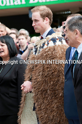 """PRINCE WILLIAM.Prince William opened the Supreme Court building in Wellington.The Prince was greeted with a traditional Maori Hongi on arrival and also wore a  Korowui (cape) made from feathers and plat fibbers.New Zealand's Primer Minister John Key accompanied Prince William. Wellington, 18/01/2010 .Mandatory Credit Photo: ©DIAS-NEWSPIX INTERNATIONAL..**ALL FEES PAYABLE TO: """"NEWSPIX INTERNATIONAL""""**..IMMEDIATE CONFIRMATION OF USAGE REQUIRED:.Newspix International, 31 Chinnery Hill, Bishop's Stortford, ENGLAND CM23 3PS.Tel:+441279 324672  ; Fax: +441279656877.Mobile:  07775681153.e-mail: info@newspixinternational.co.uk"""