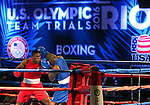 Brandon Glanton, left, and Adrian Taylor compete in the U.S. Olympic Boxing Trials in Reno, Nev., on Wednesday, Dec. 9, 2015. (AP Photo/Cathleen Allison)