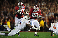 Jan 7, 2010; Pasadena, CA, USA; Alabama Crimson running back Mark Ingram (22) runs with the ball and breaks a tackle by Texas Longhorns defensive end Sergio Kindle (2) during the second quarter of the 2010 BCS national championship game at the Rose Bowl.  Mandatory Credit: Mark J. Rebilas-.