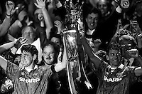 Pix:Michael Steele/SWpix...Soccer. Manchester United win the Premiership...COPYRIGHT PICTURE>>SIMON WILKINSON..Manchester United's captain Steve Bruce and Bryan Robson lift the Premiership trophy.