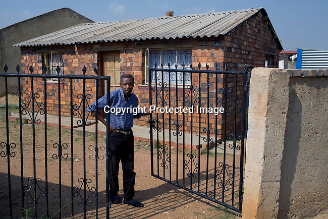 JOHANNESBURG, SOUTH AFRICA - APRIL 14:Michael Mbele, a victim of Apartheid outside his houseon April 14 2010, inSoweto, South Africa. Khulumanie is involved in the Daimler complaint brought forward by victims of Apartheid. Theplaintiffsargue that Daimler soldvehicles to the old South African government. (Photo by Per-AndersPettersson/Agentur Focus ForSpiegelMagazine)