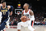 Portland Trail Blazers guard Damian Lillard (0) drives on Denver Nuggets guard Jamal Murray (27) in the second half at Moda Center. <br /> Photo by Jaime Valdez