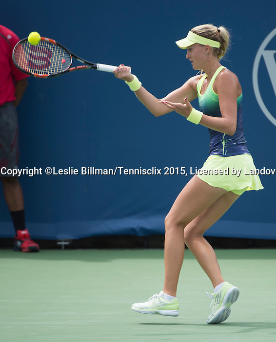 Kristina Mladenovic (FRA) splits sets with Simone Halep (ROU) 5-7, 7-5 at the Western and Southern Open in Mason, OH on August 19, 2015.