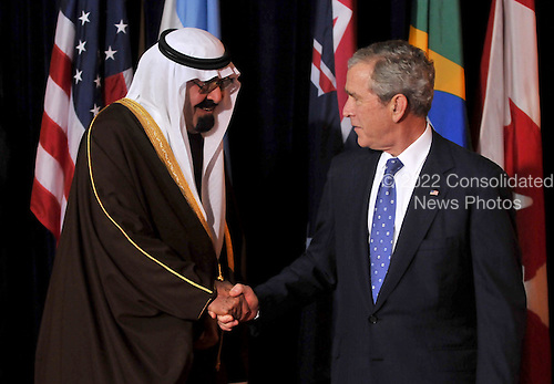 Washington, D.C. - November 15, 2008 -- United States President George W. Bush welcomes King Abdullah bin Abd al-Aziz Al Saud of Saudi Arabia to the Summit on Financial Markets and the World Economy leaders to the National Building Museum in Washington, D.C. on Saturday, November 15, 2008..Credit: Ron Sachs / Pool via CNP