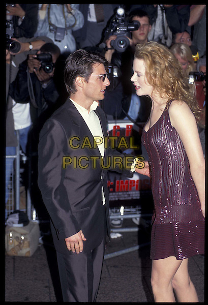 TOM CRUISE & NICOLE KIDMAN.04 July 1996.Ref: 3033.ex celebrity couple, divorced, half length, half-length, cameras, paparazzi.*RAW SCAN- photo will be adjusted for publication*.www.capitalpictures.com.sales@capitalpictures.com.©Capital Pictures