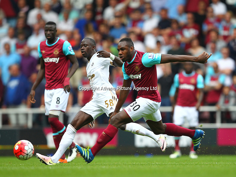 Modou Barrow of Swansea and Michail Antonio of West Ham United   during the Barclays Premier League match between West Ham United and Swansea City  played at Boleyn Ground , London on 7th May 2016