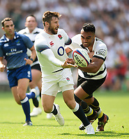 Elliot Daly of England offloads the ball after being tackled by Victor Vito of the Barbarians. Quilter Cup International match between England and the Barbarians on May 27, 2018 at Twickenham Stadium in London, England. Photo by: Patrick Khachfe / Onside Images