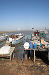 Houseboats. Small fishing and sailing hamlet of Felixstowe Ferry at the mouth of the River Deben, Suffolk, England