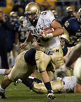 Navy Fullback Eric Kettani runs through a University of Pittsburgh tackler as the Midshipmen defeated the Panthers 48-45 in two overtimes on October 10, 2007 at Heinz Field in Pittsburgh, Pennsylvania.