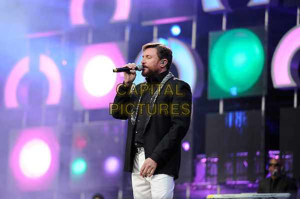 Simon Le Bon of Duran Duran <br /> Performing at the 'Chime For Change' concert, Twickenham Stadium,  London, England. 1st June 2013 <br /> music live on stage gig half length black jacket blazer white trousers microphone singing side <br /> CAP/MAR<br /> &copy; Martin Harris/Capital Pictures