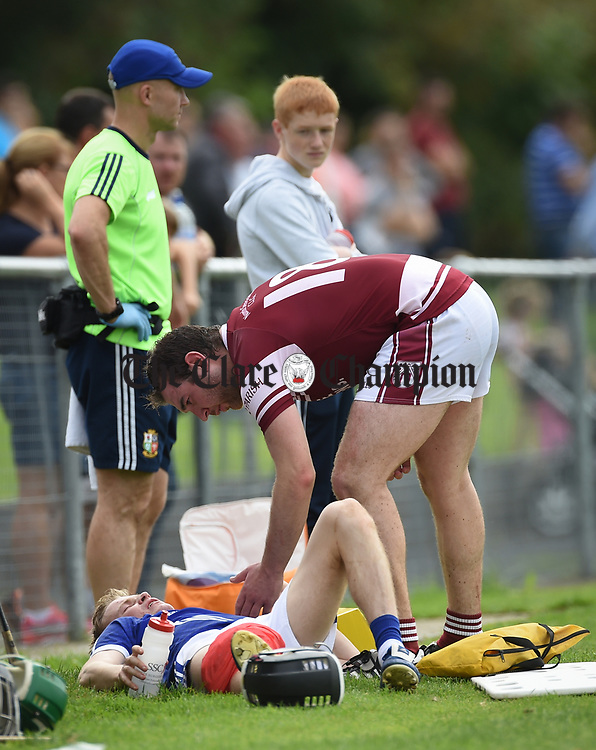 David Collins of Cratloe is consoled by opposition player Leo Duggan after he came off with an injury following a clash during their round three senior championship game against St Joseph's in Sixmilebridge. Photograph by John Kelly